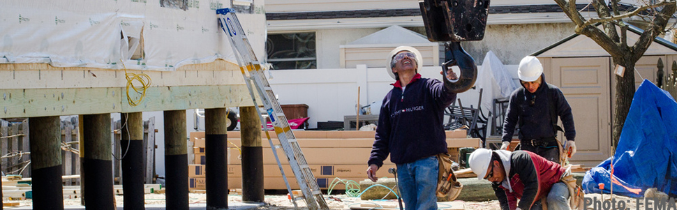 Construction Worker Elevating Home